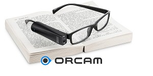 The OrCam MyEye PRO is shown resting on a book
